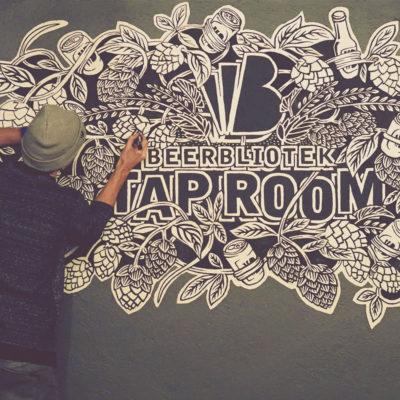 Beerbliotek Designer & Artist Darryl de Necker adding the finishing touches to the Beerbliotek Brewery Tap Room mural.