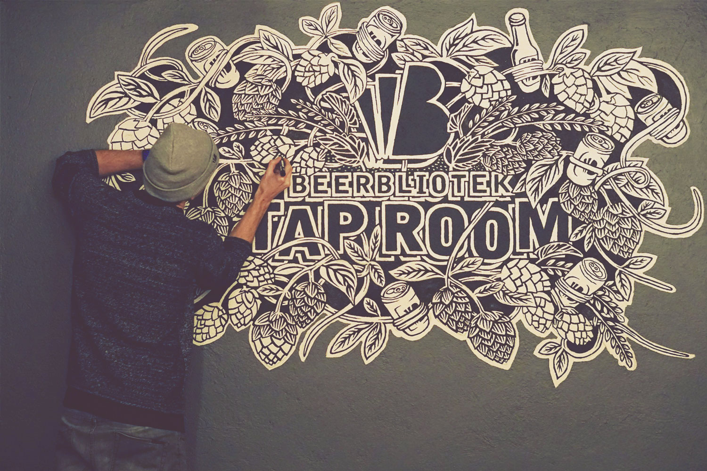 Beerbliotek Designer & Artist Darryl de Necker adding the finishing touches to the Beerbliotek Brewery Tap Room mural.